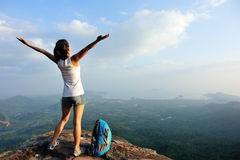 Woman hiker open arms Stock Photos