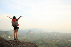 Woman hiker open arms Stock Images