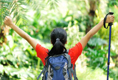 Woman hiker open arms in jungle Stock Photography