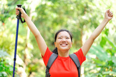 Woman hiker open arms in jungle Stock Photo