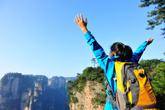Woman hiker open arms at mountain zhangjiajie Royalty Free Stock Image