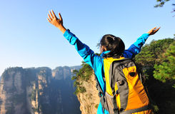 Woman hiker open arms at mountain peak zhangjiaj Stock Image