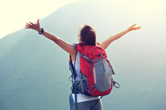 Woman hiker open arms moutain peak Royalty Free Stock Photography