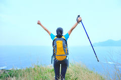 Woman hiker open arms seaside Royalty Free Stock Photography