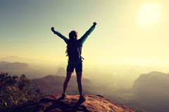 Woman hiker open arms on sunrise mountain top. Cheering successful woman hiker open arms on sunrise mountain top Royalty Free Stock Images
