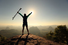 Woman hiker open arms on sunrise mountain top. Cheering successful woman hiker open arms on sunrise mountain top Stock Photography