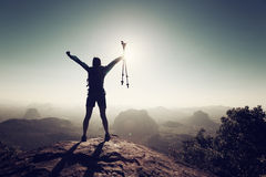 Woman hiker open arms on sunrise mountain top. Cheering successful woman hiker open arms on sunrise mountain top Stock Image