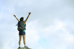 Woman hiker open arms to sky Royalty Free Stock Image