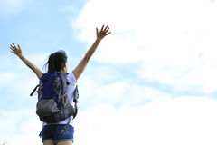 Woman hiker open arms to sky Stock Image