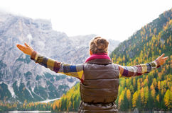 Woman hiker opening arms in joy against autumn background Stock Photography