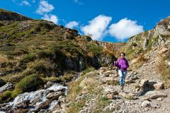 Woman hiker on the path in the french Pyrenees royalty free stock photo