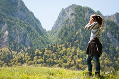 Woman hiker on the phone Royalty Free Stock Photos