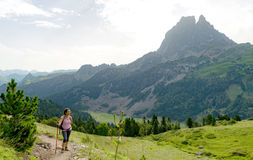 Woman hiker with Pic du Midi d`Ossau in the French Pyrenees. A woman hiker with Pic du Midi d`Ossau in the French Pyrenees Royalty Free Stock Photos
