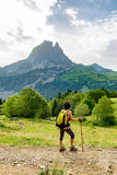 Woman hiker with Pic du Midi d`Ossau in the French Pyrenees Royalty Free Stock Images