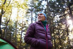 Woman hiker in the pine woods royalty free stock photo