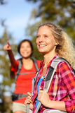 Woman hiker. Portrait in forest. Hiking girl smiling happy on hike living healthy active outdoor lifestyle. Beautiful young aspirational blonde female hikers Stock Photos