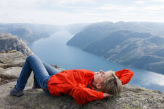 Woman hiker on Pulpit Rock / Preikestolen, Norway Stock Photos