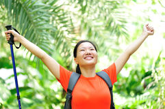 Woman hiker raised arms in jungle Stock Image