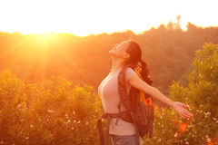 Woman hiker raised arms mountain top Stock Images