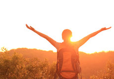 Woman hiker raised arms mountain top Royalty Free Stock Photo