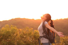 Woman hiker raised arms mountain top Royalty Free Stock Photography