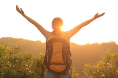 Woman hiker raised arms mountain top Stock Photo