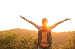 Woman hiker raised arms mountain top Royalty Free Stock Photos