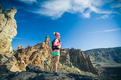 Woman hiker reached mountain top, backpacker adventure stock photo
