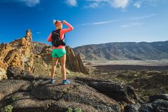 Woman hiker reached mountain top, backpacker adventure. Woman hiker reached mountain top. Inspire and motivate concept for outdoors activity. Female runner or stock photo