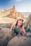 Woman hiker reached mountain top, summer activity Royalty Free Stock Images