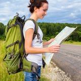 Woman hiker reading map Stock Photo