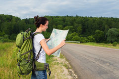 Woman hiker reading map Royalty Free Stock Photos