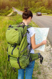 Woman hiker reading map Royalty Free Stock Photo
