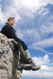 Woman hiker relaxes in mountains Stock Photography