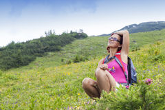 Woman hiker resting,  high in the mountain Royalty Free Stock Photography