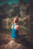 Woman hiker resting near lake Royalty Free Stock Image