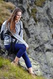 Woman hiker resting on a rock Stock Photo