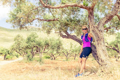 Woman hiker resting in tree grove, Crete Island, Greece Royalty Free Stock Photos