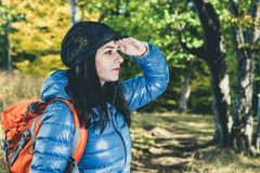Female hiker searching forest Stock Photos