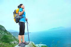 Woman hiker seaside Stock Image
