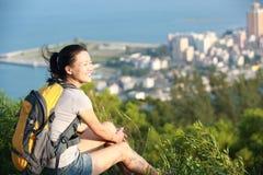 Woman hiker sit mountain peak Royalty Free Stock Images