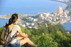 Woman hiker sit mountain peak Royalty Free Stock Photo