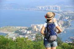 Woman hiker sit mountain peak Stock Photography