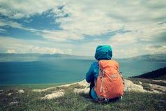 Woman hiker sit on mountain peak Royalty Free Stock Photography