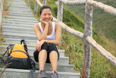 Woman hiker sit on mountain stairs Royalty Free Stock Photo