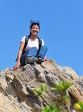 Woman hiker sit on rock Stock Images