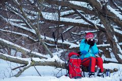 Woman, Hiker Sits Drinks Coffee In Winter Forest Stock Photos