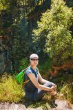 Woman hiker sitting on the top of hill Royalty Free Stock Image