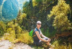 Woman hiker sitting on the top of mountain Royalty Free Stock Image