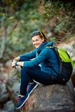 Woman hiker smiling standing outside in forest Stock Photography